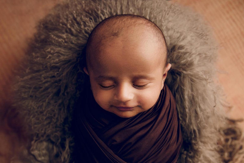 Baby Boy wrapped in brown and posed in a crate by Lifetime Stories Photography Brisbane