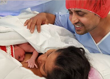 First breath of baby Ivaan and his parents watching over him with love