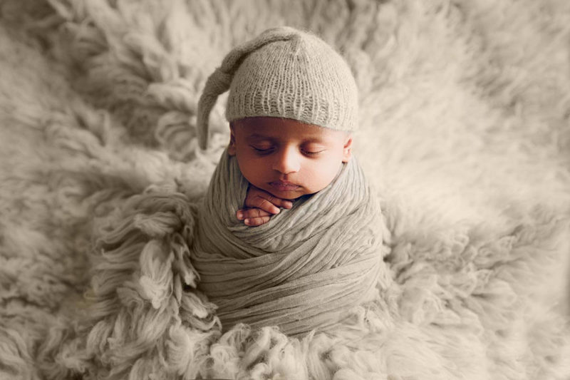 Newborn baby in a potato pose by Lifetime Stories Photography Maternity and Newborn Photographer in Brisbane