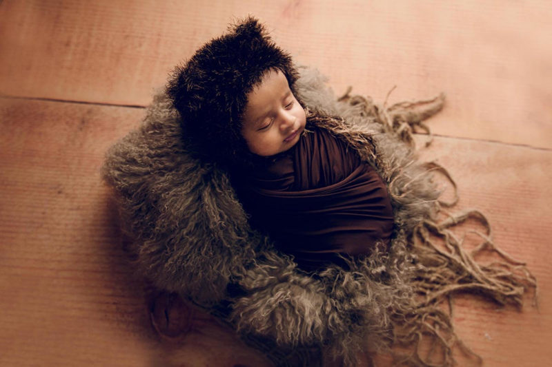 Traditional wrapped newborn photography session in Rochedale South studio by Lifetime Stories Photography South Brisbane