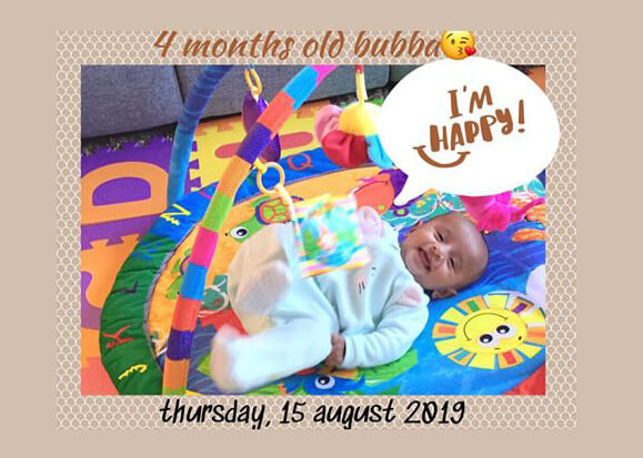 four months old baby relaxing on his play mat not a newborn anymore life in Brisbane is good